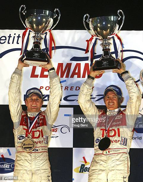 Rinaldo Capello and teammate Allan McNish of the Audi Sport North America Audi R10 celebrate after their victory in the American Le Mans Series Petit...