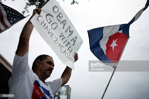 Rinaldo Martinez holds a sign reading Obama Go with Chavez and Castro as he protest against the Democratic presidential candidate US Sen Barack Obama...
