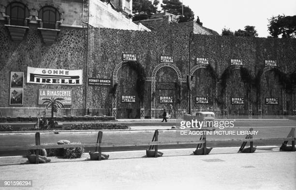 Rinascente Gomme Pirelli and Birra Italiana's advertising posters along the Superba car circuit Genoa Italy 20th century