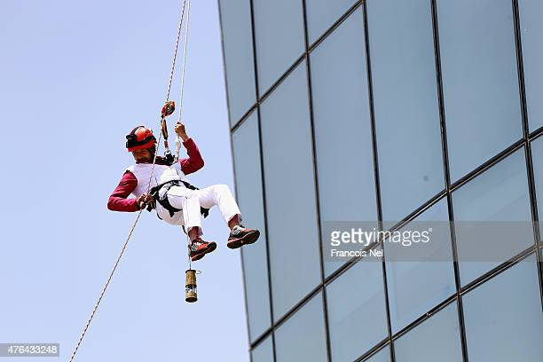 Rinat Ragimkhanov from Azerbaijan abseils down the Flame Towers as part of the Baku 2015 Journey of the Flame on June 9 2015 in Baku Azerbaijan