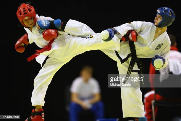Rinat Suleymanov of Russia competes with Ben Meyrick of Wales in the Individual Sparring Child Male 40kg during day two of the 2017 European...