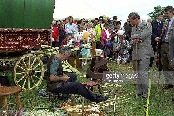 Rince Charles Watching A Craftsman At The Cheshire Show Behind The Prince Is His Police Bodyguard Peter Brown Wearing Brown Suit
