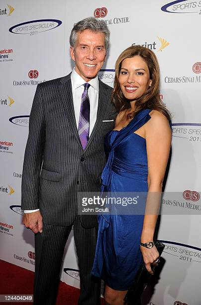Ring announcer Michael Buffer and guest arrive at the 2011 Cedars Sinai Sports Spectacular at Hyatt Regency Century Plaza on May 22 2011 in Beverly...