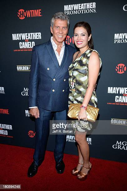 Ring announcer Michael Buffer and his wife Christine Buffer arrive at the Floyd Mayweather Jr vs Canelo Alvarez boxing match at the MGM Grand Garden...