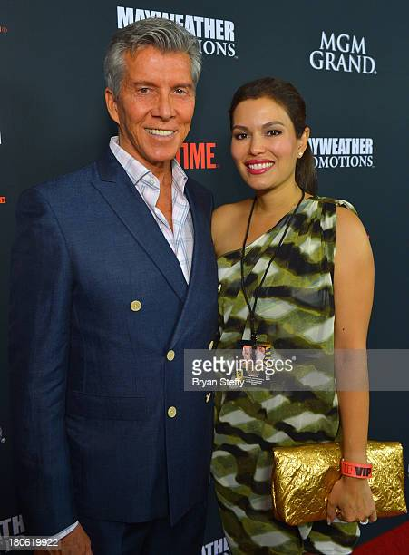 Ring announcer Michael Buffer and his wife Christine Buffer arrive at the MGM Grand Garden Arena for the Floyd Mayweather Jr vs Canelo Alvarez boxing...