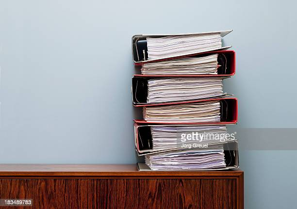 ring binders on cabinet - stack stock photos and pictures