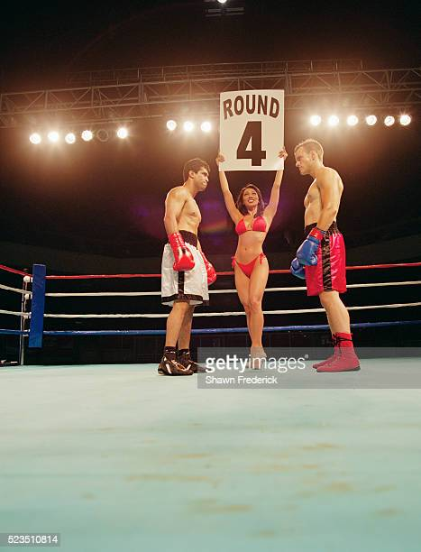 Ring Card Girl Between Two Boxers