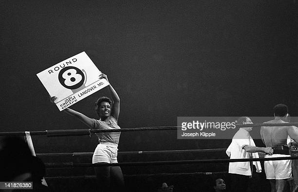 A 'ring girl' announces the 8th round in a Heavyweight Championship bout between American boxer Muhammad Ali and Uruguayan Alfredo Evangelista at the...