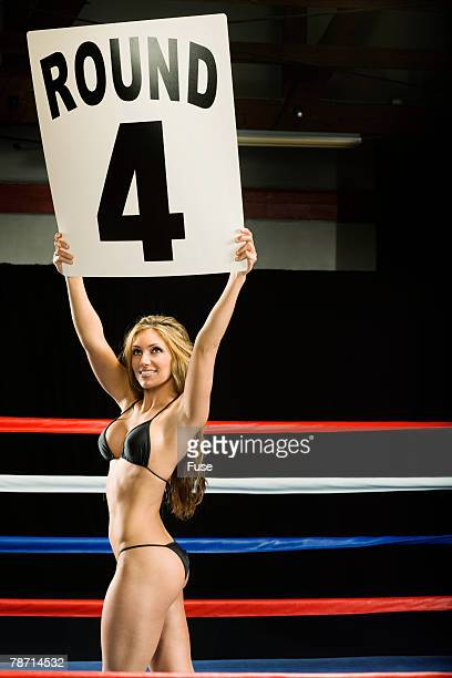 Ring Girl Announcing Start of Boxing Round