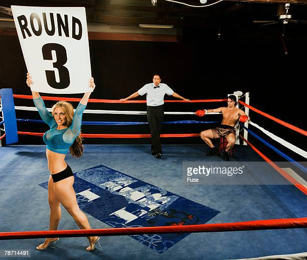 Ring Girl Announcing Start of Round Three