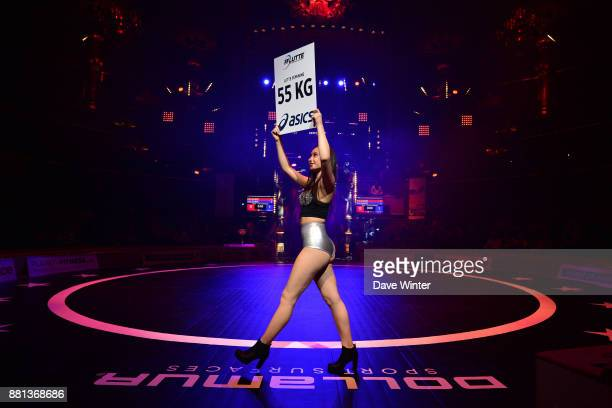 Ring girl announcing the weight categories during the International wrestling test match between France and Bulgaria at Le Cirque d'Hiver on November...