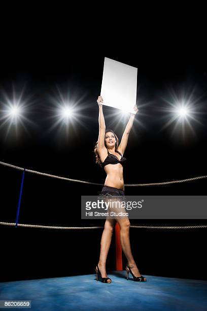 ring girl holding sign in boxing ring - boxing ring stock pictures, royalty-free photos & images