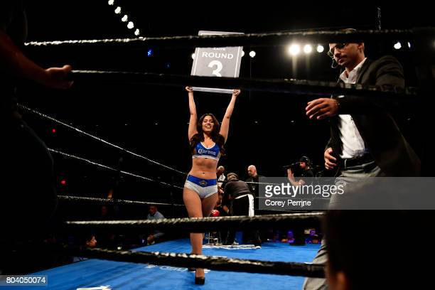 A ring girl holds up a card in the third round as Avery Sparrow takes on Isaelin Florian during a lightweight bout at the Sands Bethlehem Event...