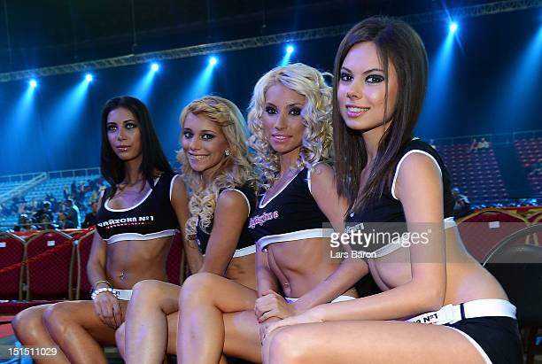 Ring girls are seen prior to the WBCheavy weight title fight between Vitali Klitschko of Ukraine and Manuel Charr of Germany at Olimpiyskiy Arena on...