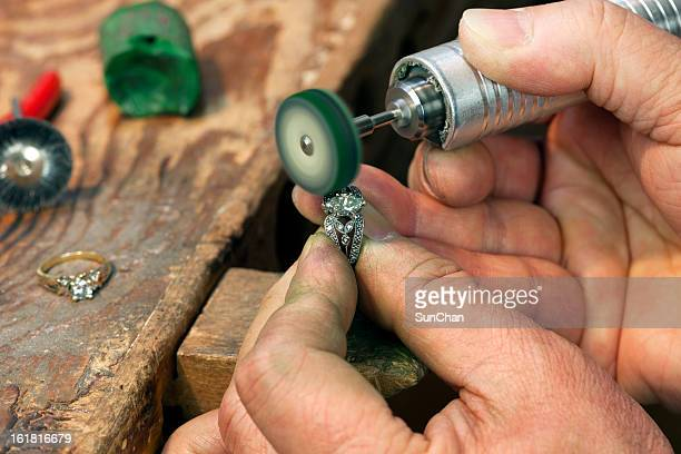 ring repairing & polishing - jeweller stock photos and pictures