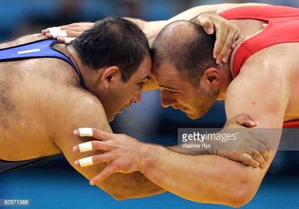 Ringen Olympische Spiele Athen 2004 Athen Freistil / 120kg / Maenner Artur TAYMAZOV / UZB Gold Alireza REZAEI / IRI / Silber 280804
