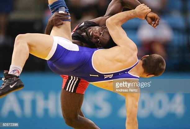 Ringen Olympische Spiele Athen 2004 Athen Freistil /60kg / Maenner Finale GOLD Yandro QUINTANA / CUB SILBER Masuod JOKAR / IRI 290804