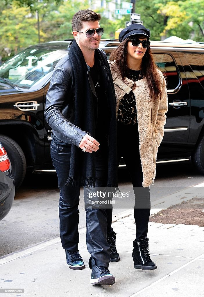 Ringer Robin Thicke and wife Paula Patton are seen in Soho on October 23, 2013 in New York City.
