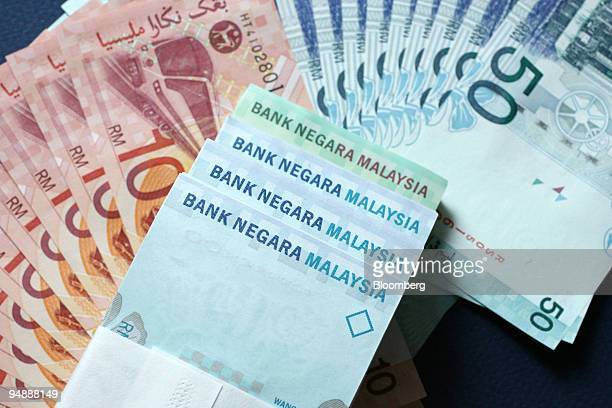 Ringgit notes issued by Bank Negara Malaysia the nation's central bank are arranged for a photograph in Kuala Lumpur Malaysia on Sunday Jan 27 2008...