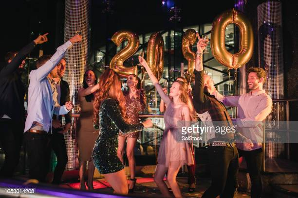 ringing in the 2020 new year - happy new year 2020 stock photos and pictures