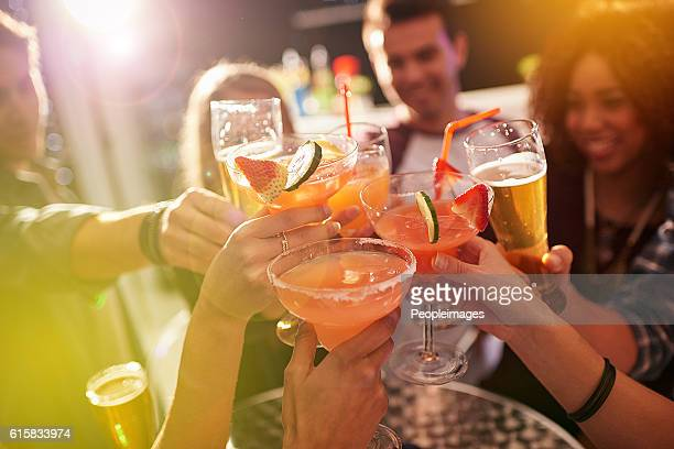 ringing in the weekend - happy hour stock pictures, royalty-free photos & images