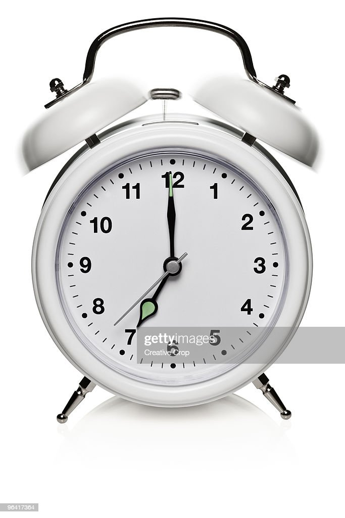 Ringing white alarm clock : Stock Photo