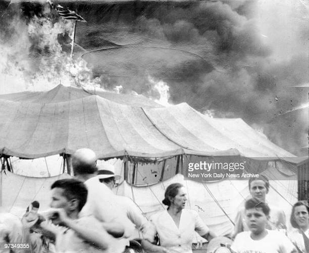 Ringling Bros. & Barnum & Bailey Circus Fire , People rushing out of fire tent.