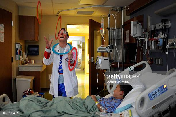 Ringling Bros clown Mike Ringling juggles for Bryan Azucar during a good will trip to Rocky Mountain Hospital for Children on Wednesday September 7...