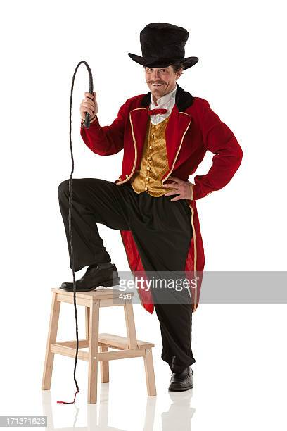 Ringmaster performing with a whip