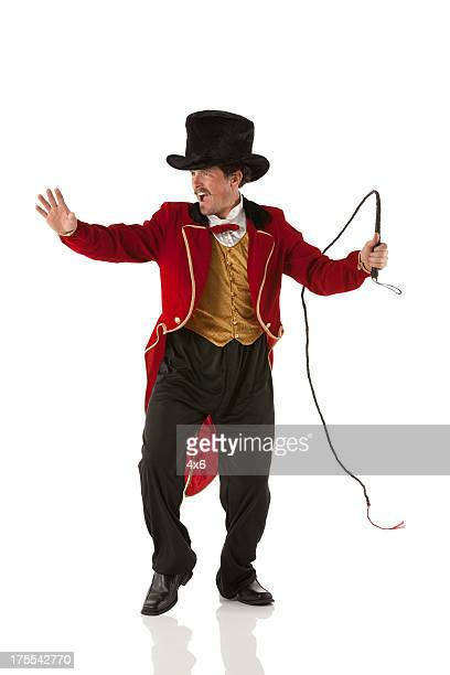 Ringmaster perfroming with a whip