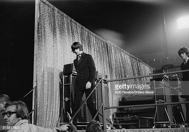 Ringo Starr and George Harrison of The Beatles leave the stage after a show at Dodger Stadium Los Angeles California August 28 1966