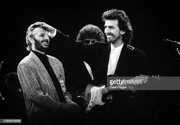 Ringo Starr and George Harrison perform during a concert for the Princes Trust, attended by Princess Diana and Prince Charles, at Wembley Stadium,...