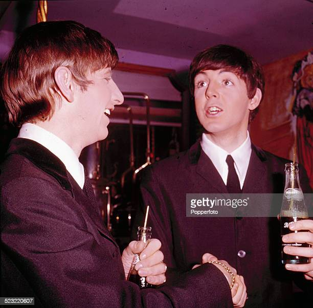 Ringo Starr and Paul McCartney from The Beatles hold bottles of Pepsi Cola in Paris France in January 1964