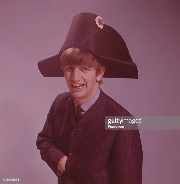 Ringo Starr drummer with the Beatles posed wearing a bicorne hat in a photographic studio in Paris in January 1964