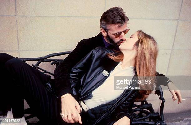 Ringo Starr formerly of the Beatles kissing his wife Barbara Bach London 1981
