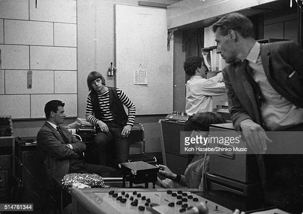 Ringo Starr George Harrison of The Beatles and producer George Martin in the control room of Studio 2 EMI Studios Abbey Road London during the...