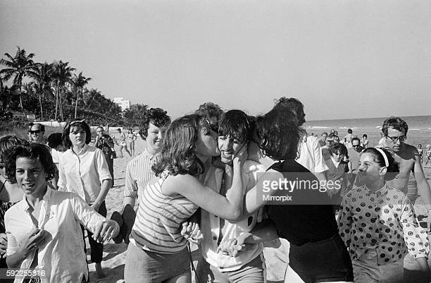 Ringo Starr is besieged by schoolgirls as he strolls on a beach in Miami Florida as the group enjoy a short break during their Winter 1964 US Tour...