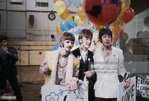 Ringo Starr John Lennon and Paul McCartney of the Beatles pictured together during a press call at Abbey Road studios prior to their performance of...