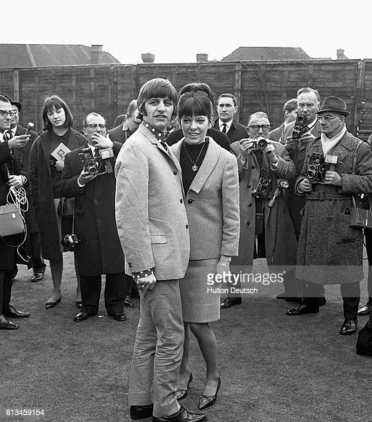 Ringo Starr of the Beatles and his wife Maureen Beatles drummer Ringo Starr gives a cuddle for the benefit of photographers to his newlywed wife 18...