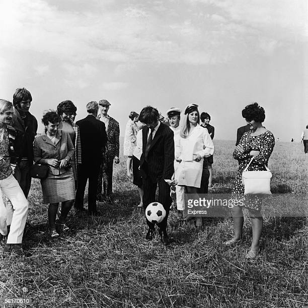 Ringo Starr of the Beatles demonstrates his football skills during a break in the filming of 'Magical Mystery Tour' on location 16th September 1967