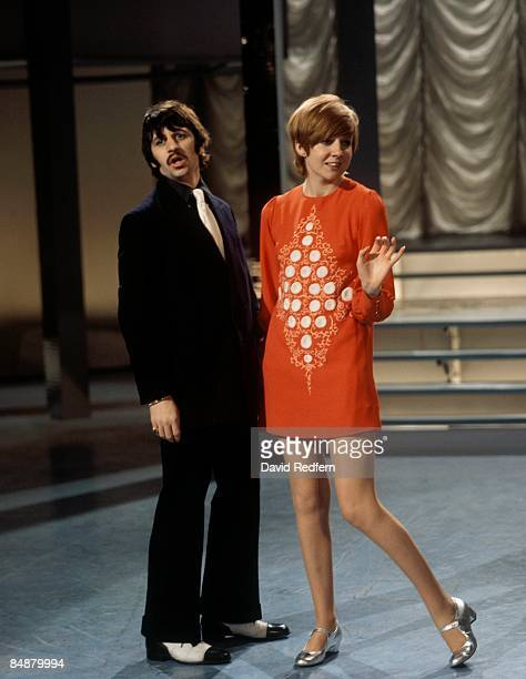 Ringo Starr of The Beatles performs the duet 'Do You Like Me' with singer Cilla Black on the BBC Show of the Week 'Cilla' at BBC Television Theatre...