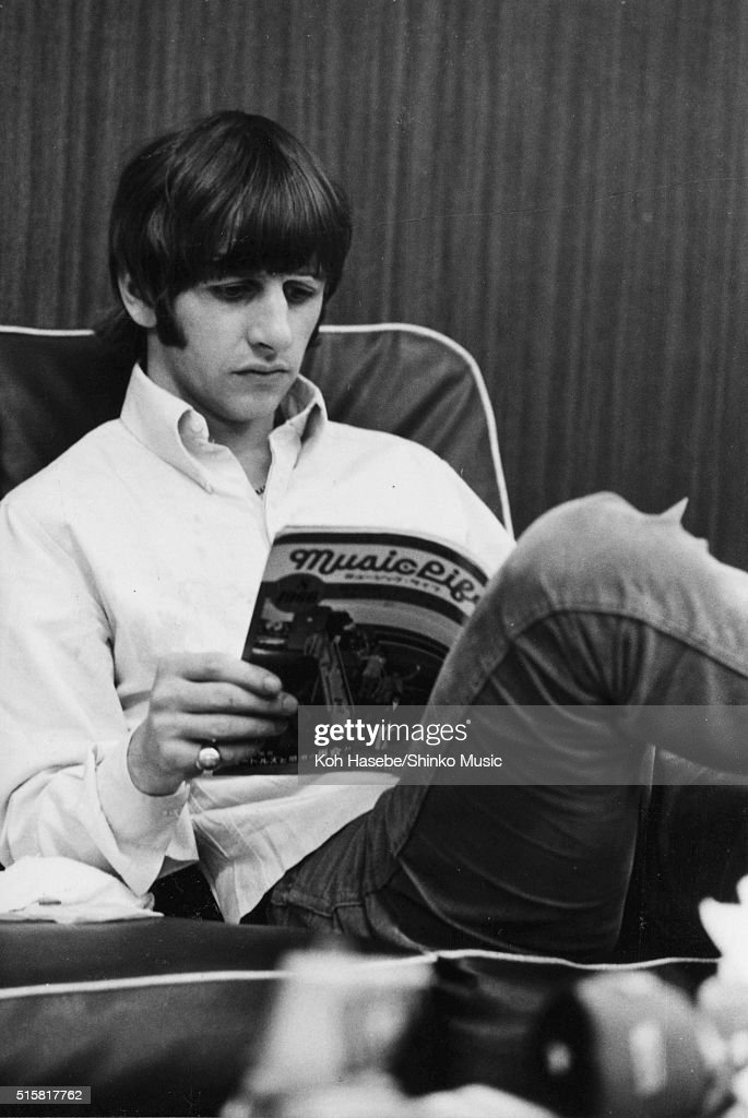 Ringo Starr of The Beatles reads a copy of Japanese music