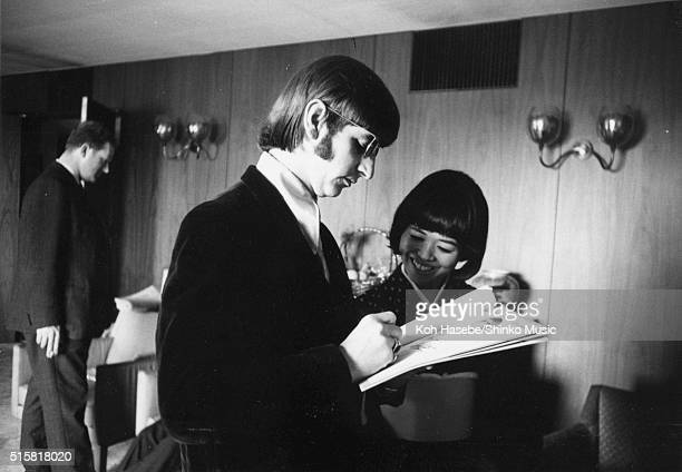 Ringo Starr of the Beatles signs an autograph during an interview with journalist Rumi Hoshika for Japanese music magazine 'Music Life' Tokyo Hilton...