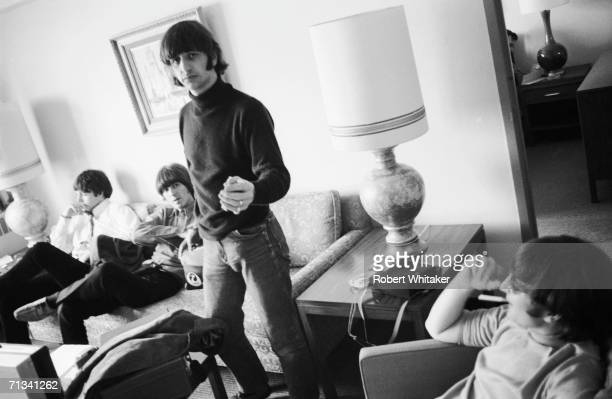 Ringo Starr offers Bob Whitaker a cigarette while the rest of the Beatles count down the hours in Anchorage enroute to a tour of Japan Brian Epstein...