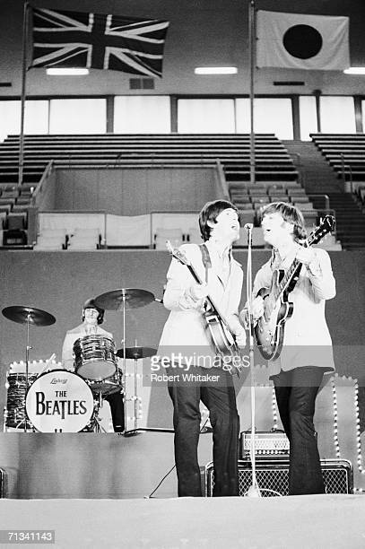Ringo Starr Paul McCartney and John Lennon on stage during the Beatles concert at Tokyos Budokan Hall Japan 2nd July 1966