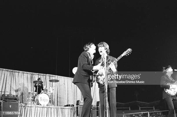 Ringo Starr Paul McCartney George Harrison and John Lennon of The Beatles perform on stage at the Dodger Stadium Los Angeles California United States...