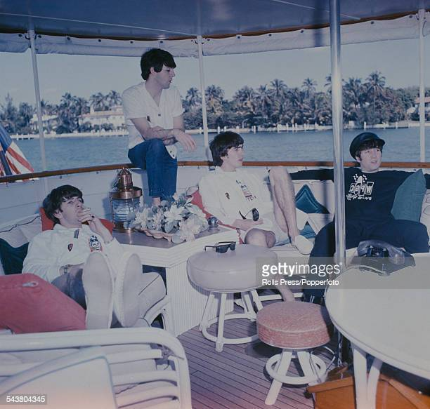 Ringo Starr Paul McCartney George Harrison and John Lennon of The Beatles relax on a houseboat off Miami harbour in the United States in February 1964