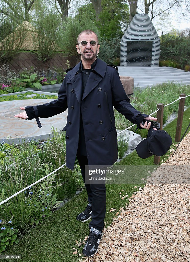 Ringo Starr poses in the B&Q Sentebale 'Forget-Me-Not' Garden at the Chelsea Flower Show at Royal Hospital Chelsea on May 20, 2013 in London, England. The B&Q Sentebale 'Forget Me Not' Garden was designed by renowned garden designer Jinny Blom and includes native Lesotho flowers and a contemporary pavilion based on a Traditional Basotho roundhouse. The garden was built to raise awareness of the work of Prince Harry's charity Sentebale and the plight of the children of this small African Kingdom.
