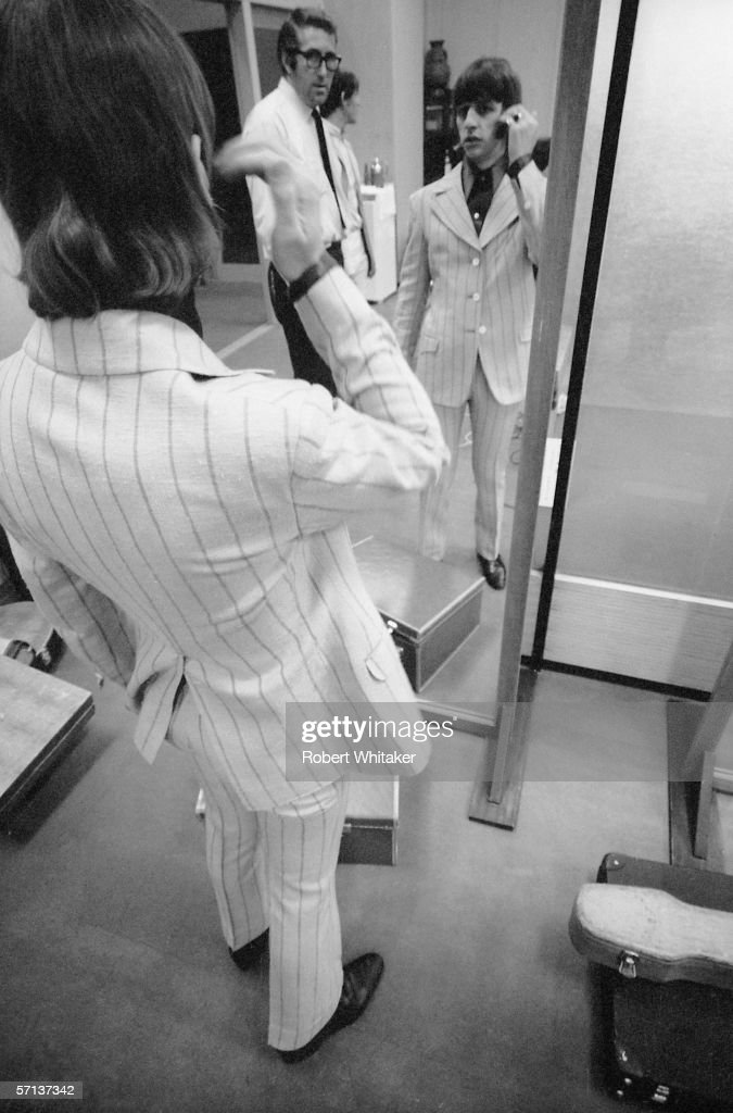 Ringo Starr prepares himself for a concert in Tokyo during the Beatles' Asian tour, watched by loyal roadie Mal Evans, 2nd July 1966.