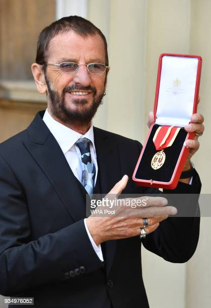 Ringo Starr real name Richard Starkey poses at Buckingham Palace after receiving his Knighthood at an Investiture ceremony on March 20 2018 in London...